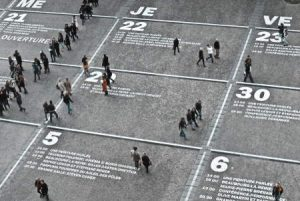 This image includes people walking across a street that has be digitally enhanced to appear as a calendar. This image is placed here to provide a visual for the text about the time it takes for NJ SEO to work.